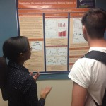 Lauren Wyatt presents her poster to graduate students at CSETAC.