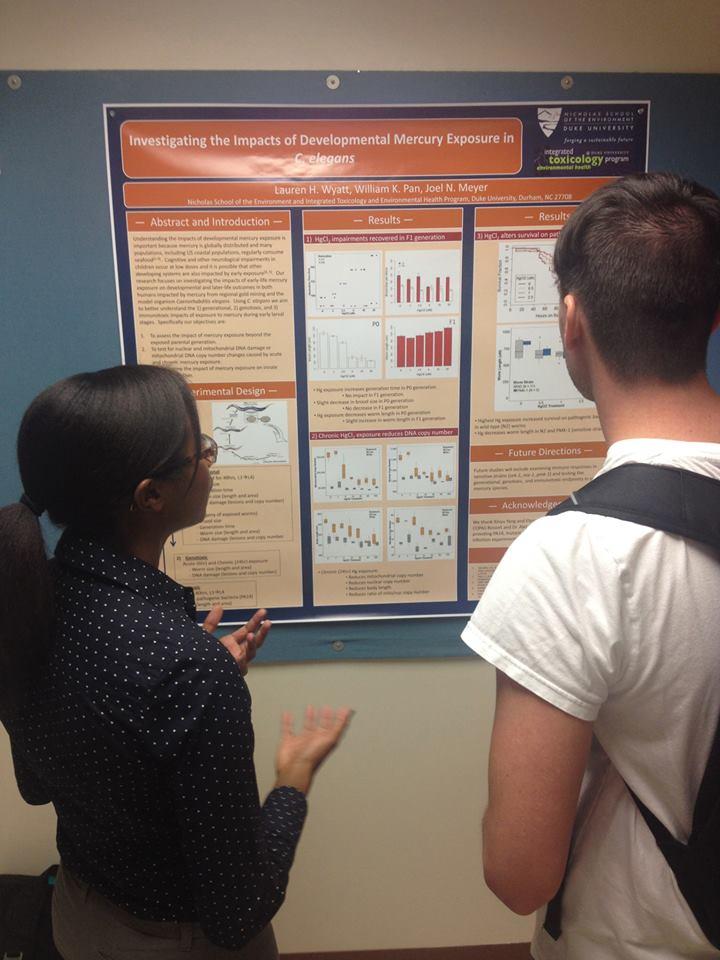 Lauren Wyatt presents her poster to graduate students at CSETAC.
