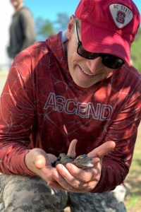 Dr. Scott Belcher with baby American Alligator