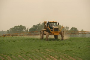 Spraying corn, Image by PI77, used under Creative Commons license.