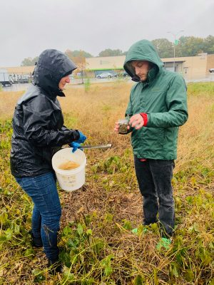 Catherine Kastleman and Sam Cohen grabbing soils samples